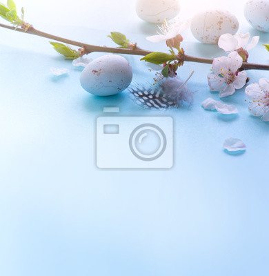 Easter Eggs with Spring Flowers on blue Background