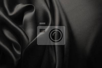 Naklejka Elegancki czarny satynowy jedwab z falami, abstrakcjonistyczny tło