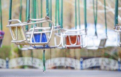Naklejka Empty chain swing in amuzement park