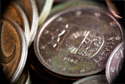 Euro coins, Macro. Euro currency on the table. A lot of coins of a few euro cents, extreme close up. Macro coins. European Business, Economics and Finance, concept.