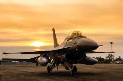 Naklejka F16 Falcon myśliwców odrzutowych na tle słońca