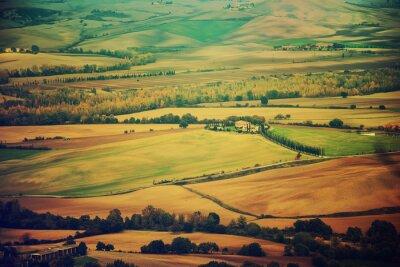 Naklejka Faliste pola w Toskanii o zachodzie słońca, Włochy.