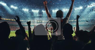 Naklejka Fani świętujący sukces ulubionej drużyny sportowej na trybunach profesjonalnego stadionu podczas padającego śniegu
