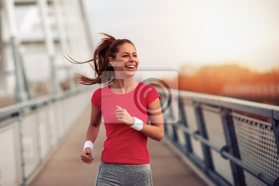 Naklejka Fitness woman running in the city