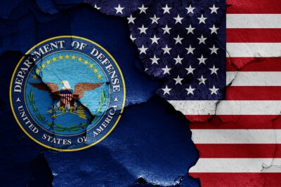 Naklejka flags of Department of Defense and USA painted on cracked wall