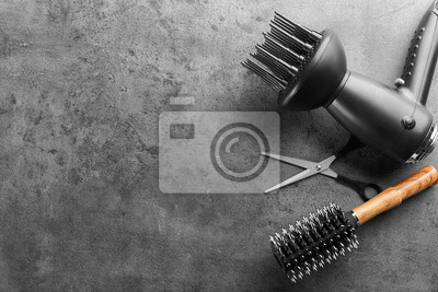 Naklejka Flat lay composition with set of hairdresser's tools on grey background