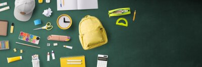 Flat lay top view of bag and school supplies, back to school concept.
