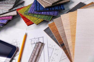 flooring and furniture materials - floor carpet and wooden laminate samples for interior design project