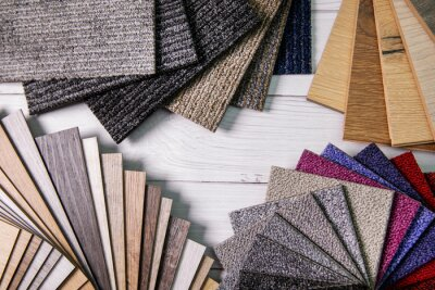 flooring and furniture materials - floor carpet and wooden laminate samples. top view