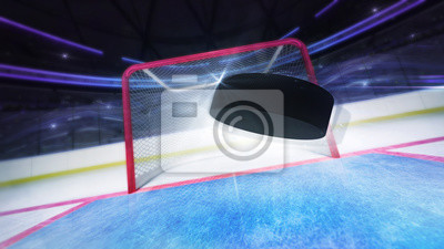 flying hockey puck goal score shot and blurred arena background