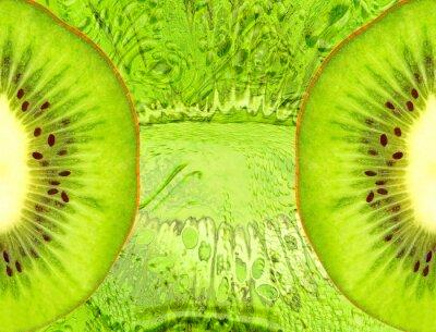 Naklejka Food background with green kiwi slices.