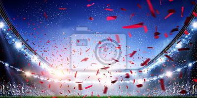 Naklejka Football stadium background with flying confetti