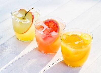 Naklejka Fresh fruit juice from oranges apples pink grapefruit