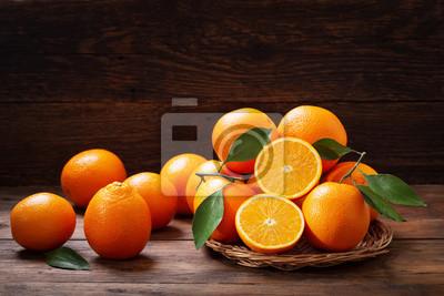 Naklejka fresh orange fruits with leaves