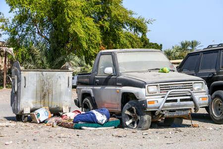 Naklejka Fujairah, UAE - November 18, 2018: Abandoned car Daihatsu Feroza near the trash can.