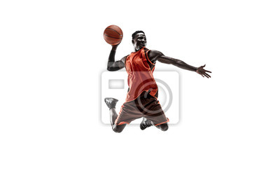 Naklejka Full length portrait of a basketball player with a ball isolated on white studio background. advertising concept. Fit african american athlete jumping with ball. Motion, activity, movement concepts.
