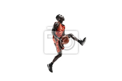 Naklejka Full length portrait of a basketball player with a ball isolated on white studio background. advertising concept. Fit african anerican athlete jumping with ball. Motion, activity, movement concepts.