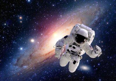 Naklejka Garnitur astronauta kosmonauta kosmos ludzie układ słoneczny wszechświat. Elementy tego zdjęcia dostarczone przez NASA.