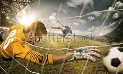 Naklejka Goalkeeper in gates jumping to catching ball