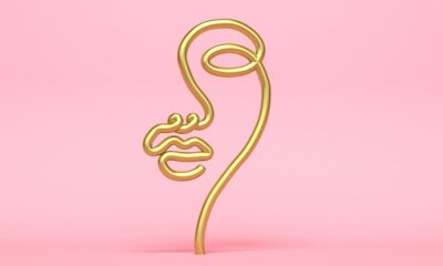 Golden abstract silhouette of a woman face on a pink background. Backdrop design for product promotion. 3d rendering