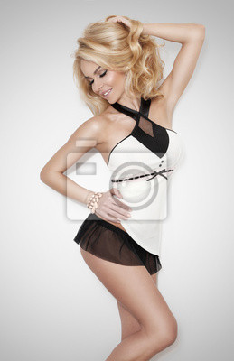 Gracious young woman with blond long your hair is sensual