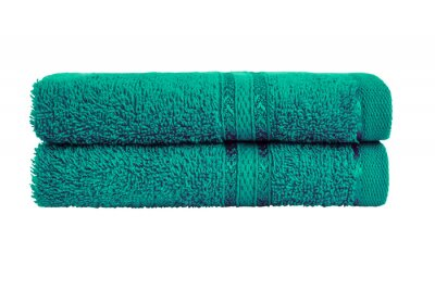 Green bath towels in stack. Isolated over white background with clipping path.