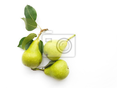 Naklejka Green pears with leaves isolated on white background, top view