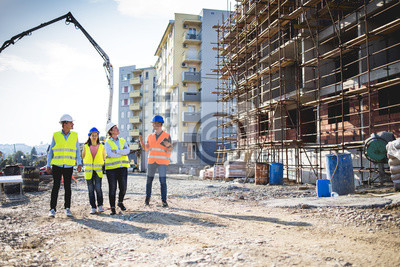 Naklejka Group of construction workers on building site.Stock photo