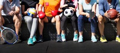 Naklejka Group of diverse athletes sitting together