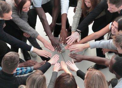 Naklejka Group of Diverse Hands Together Joining Concept