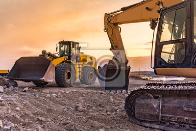 Naklejka Group of excavator working on a construction site