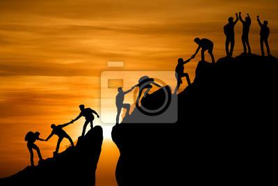 Naklejka Group of people on peak mountain climbing helping team work , travel trekking success business concept