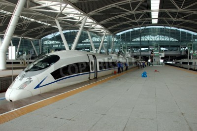Naklejka GUANGZHOU, CHINA - SEPTEMBER 29: China invests in fast and modern railway, trains with speed over 340 km/h. Train to Wuhan on September 29, 2010 waits in newly build Guangzhou South station.