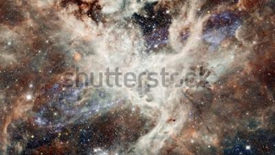 Naklejka Gwiaździste niebo noc mgławicy w kolorach. Wielokolorowa przestrzeń zewnętrzna. Głęboka przestrzeń o wiele lat świetlnych od planety Ziemia. Elementy tego zdjęcia dostarczone przez NASA