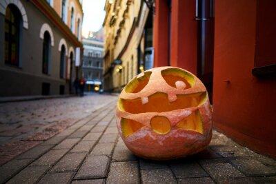 Halloween Pumpkin on old town street in Riga