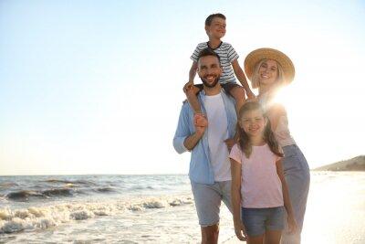 Happy family on beach near sea. Summer vacation