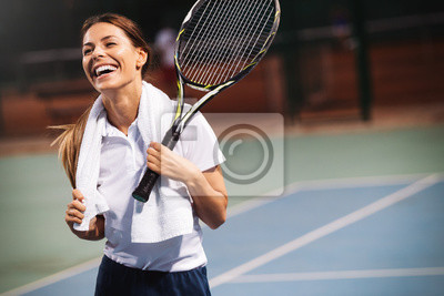 Naklejka Happy fit girl playing tennis together. Sport concept