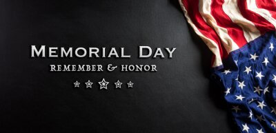 Naklejka Happy memorial day concept made from american flag with text on black wooden background.