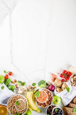 Naklejka Healthy food. Selection of good carbohydrate sources, high fiber rich food. Low glycemic index diet. Fresh vegetables, fruits, cereals, legumes, nuts, greens.  copy space