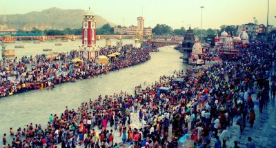 Naklejka High Angle View Of People At Ganges River Taking Ritual Bath