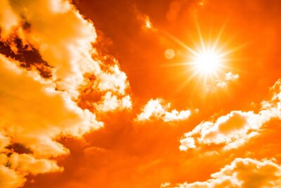Naklejka Hot summer or heat wave background, orange sky with glowing sun and clouds