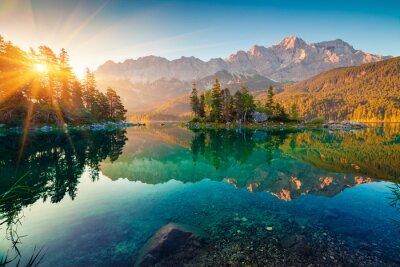 Naklejka Impressive summer sunrise on Eibsee lake with Zugspitze mountain range. Sunny outdoor scene in German Alps, Bavaria, Germany, Europe. Beauty of nature concept background.