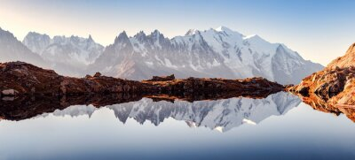 Naklejka Incredible view of clear water and sky reflection on Chesery lake (Lac De Cheserys) in France Alps. Monte Bianco mountains range on background. Landscape photography, Chamonix.