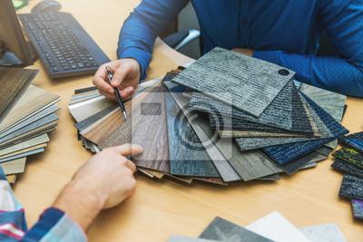 interior design - customer choosing floor material from samples at flooring shop