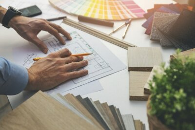 interior designer working with house plan blueprints in office