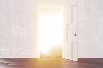 Naklejka Jasne światło z otwartych drzwi pustego pokoju