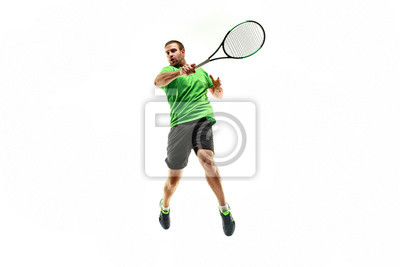 Naklejka Jeden caucasian mężczyzna bawić się tenisa odizolowywającego na białym tle. Strzał studio sprawnego młodego gracza w studio w ruchu lub ruchu podczas gry sportowej.
