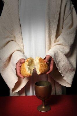 Jezus łamiąc chleb jako symbol Komunii