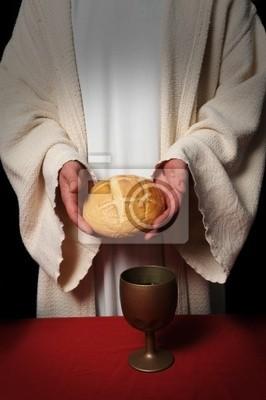 Jezus ręce gospodarstwa chleb w tabeli Communion