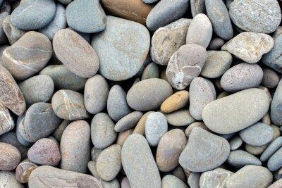 Naklejka Kamienie na plaży w tle
